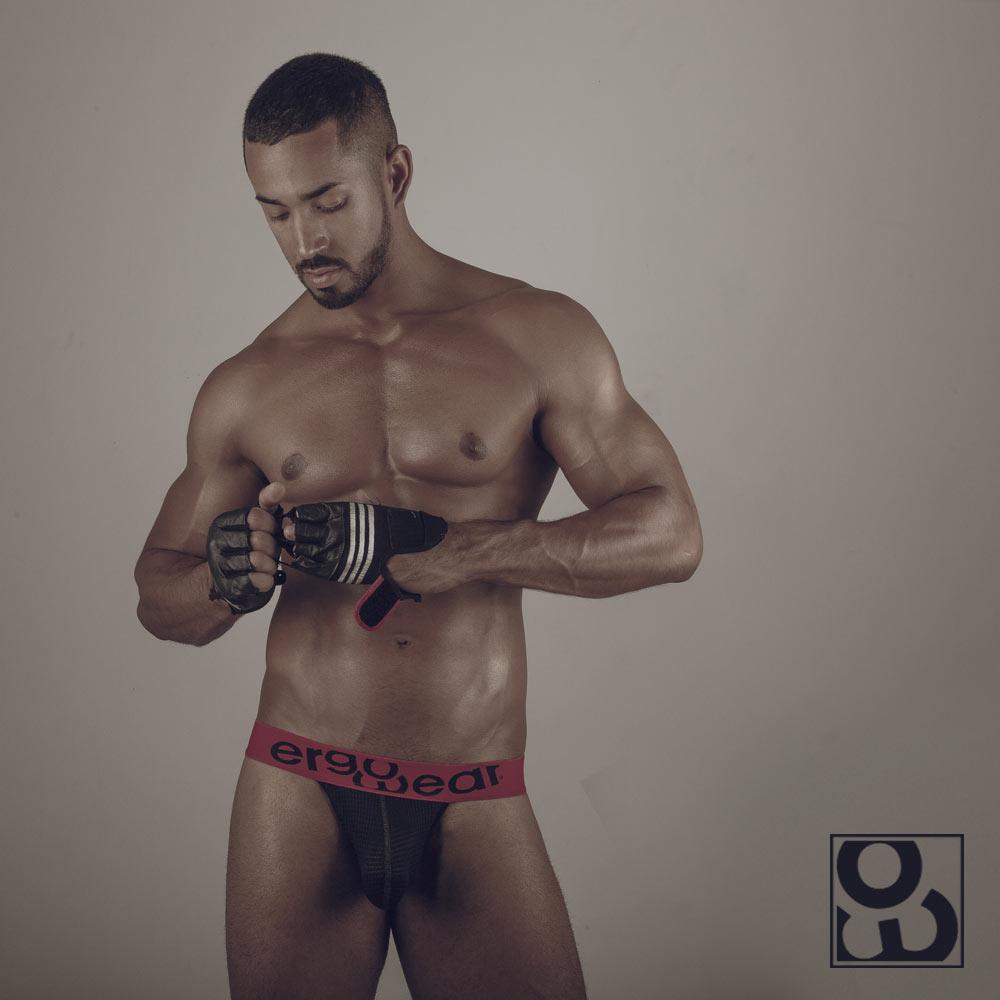 Male model wearing MAX Mesh bikini black/red