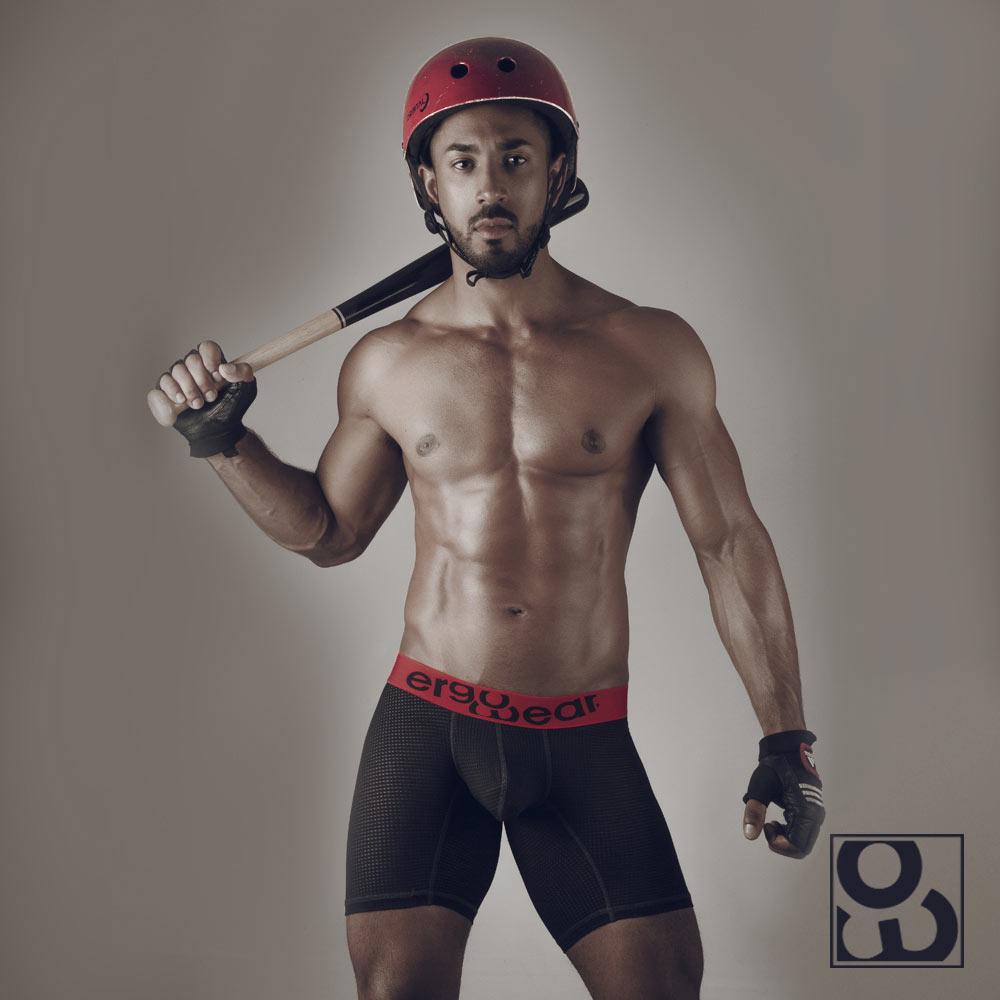 Male model with helmet wearing MAX Mesh midcut black/red